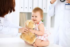 Happy cute baby  after health exam at doctor`s office. Happy cute baby after health exam at doctor`s office Royalty Free Stock Image