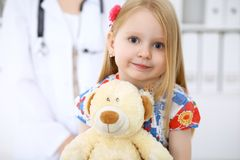 Happy cute baby after health exam at doctor`s office.  Stock Photos