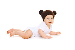 Happy cute baby in knitted hat with ears bears crawls on white Stock Photos
