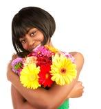 Black woman with gerbera flowers Stock Photos