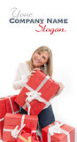 Happy cute blonde opening presents Stock Images