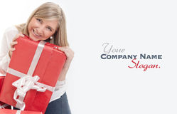 Happy cute blonde receiving presents close-up Royalty Free Stock Photos