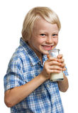 Happy cute boy drinking bottle of milk. Royalty Free Stock Image