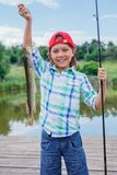 Cute boy enjoyed the fishing Stock Photos