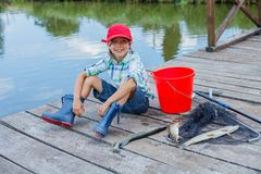 Cute boy enjoyed the fishing Stock Images