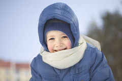 Happy Cute Boy In Hooded Jacket Stock Images