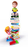 Happy cute boy sitting on the heap of books Royalty Free Stock Image