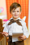 Happy cute boy waiter in apron writing order and Stock Photo