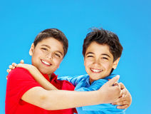 Happy cute boys over blue sky Stock Images