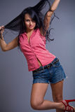 Happy cute brunette girl wearing shorts royalty free stock images