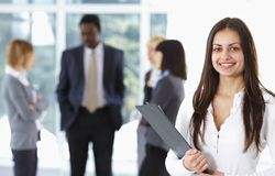 Happy cute businesswoman with colleagues Stock Photography