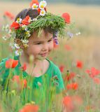Happy cute child girl on poppies field Stock Photo