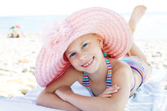 Happy cute child lying down on deckchair of beach resort Stock Photography