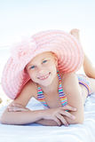 Happy cute child lying down on deckchair of beach resort Royalty Free Stock Image