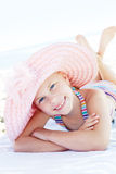 Happy cute child lying down on deckchair of beach resort Royalty Free Stock Photography