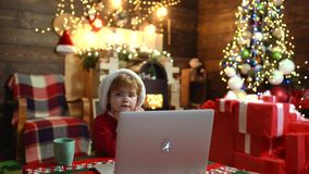 Christmas online shopping. Discount in online shop, Internet Christmas store. Happy cute child in Santa hat with present stock video