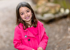 Happy cute child standing in a park Stock Photography