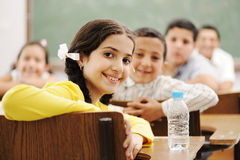 Happy cute children in classroom Royalty Free Stock Photography