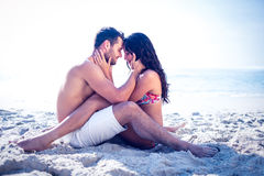 Happy cute couple hugging at the beach Stock Images