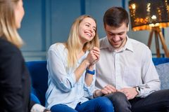 Happy cute couple with a set of keys from their own house, flat. royalty free stock photography