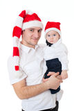 Happy cute family father and son in santa's hats Stock Photos