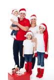 Happy cute family in santa's hats Stock Photo