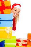 Happy cute female Christmas Santa with gifts Stock Photos