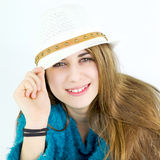 Happy cute female teenager smiling with hat Stock Images