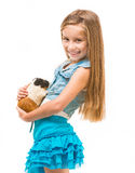 Happy cute girl with a cavy. Studio shot isolated on white background Royalty Free Stock Photo