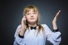 Happy cute girl with cell phone. isolated on gray Royalty Free Stock Images