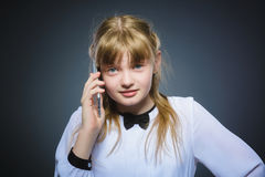 Happy cute girl with cell phone. isolated on gray Royalty Free Stock Photo