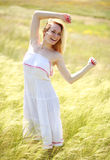 Happy cute girl enjoying a sunny summer day Royalty Free Stock Photography