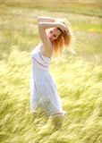 Happy cute girl enjoying a sunny summer day Stock Photography