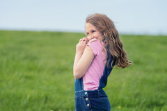 Happy cute girl in field Stock Photography