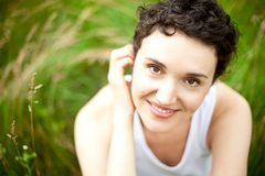 Happy cute girl on green field Royalty Free Stock Photos