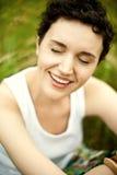 Happy cute girl on green field Stock Photo