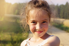 Happy cute girl making selfie over sunny park. Cute preteen Girl. Smiling very happy, surprised on Summer background. Looking at camera Royalty Free Stock Image