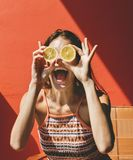 Happy cute girl with oranges stock photography