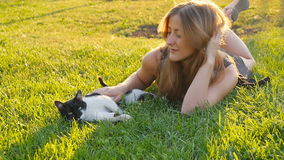 Happy cute girl playing with adorable cats stock footage