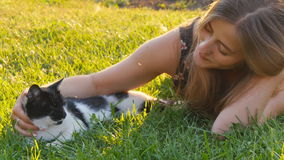 Happy cute girl playing with adorable cats stock video footage