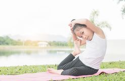 Happy cute girl playing gymnastic on outdoor park Royalty Free Stock Photography