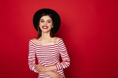 Happy cute girl in striped blouse and black hat stock photos