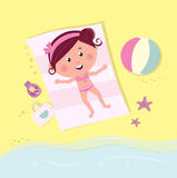 Happy cute girl sunbathing on beach Stock Image