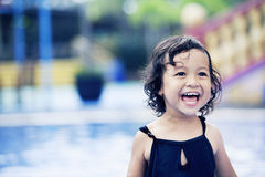 Happy cute girl at swimming pool Royalty Free Stock Images