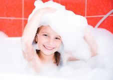 Happy cute girl is taking a bath Stock Photography
