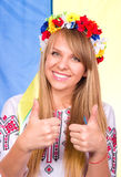 Happy cute girl in the Ukrainian national costume and Ukrainian flag Stock Image