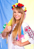 Happy cute girl in the Ukrainian national costume and Ukrainian flag Royalty Free Stock Photography