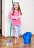 Little girl washing the floor Stock Photos