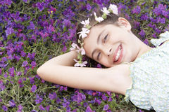 Happy Cute Girl Wearing Garland Crown Lying On Field Stock Images