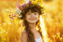 Happy cute girl wearing a wreath of flowers Stock Photography